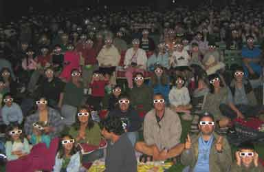 3-D movie fans with glasses