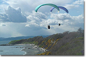 Paragliding above the Dallas Road shoreline path