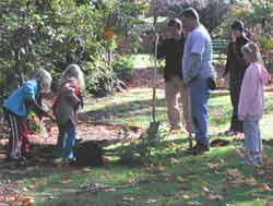 Kids take part in planting the trees